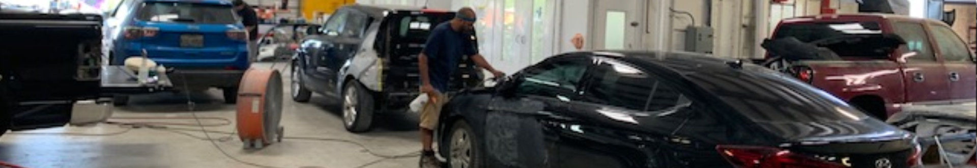 african man cleaning the car